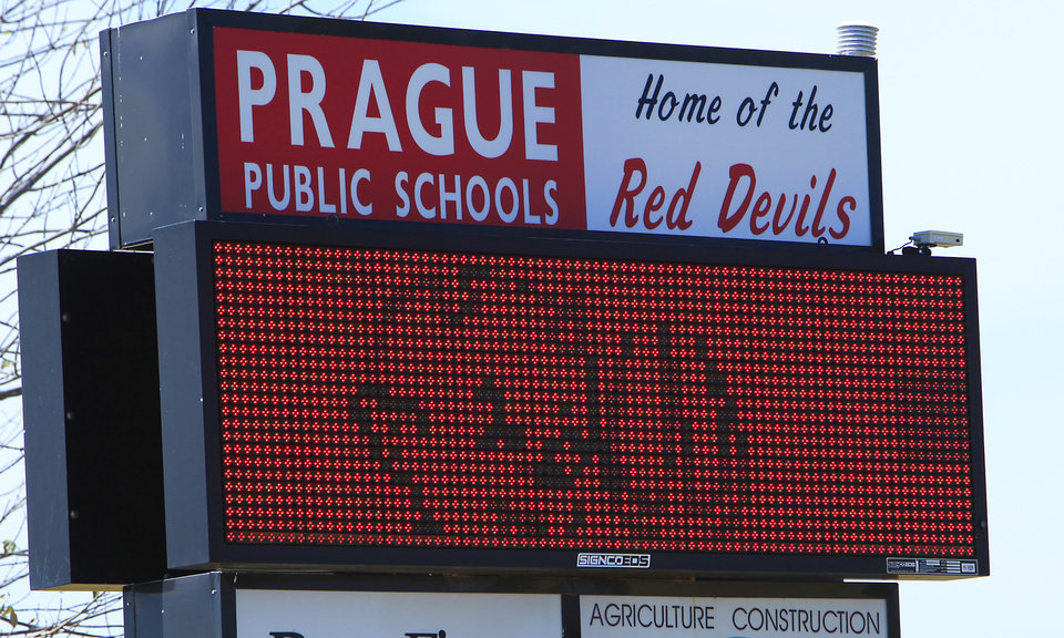 Photo - Home of the Red Devils. Prague school sign, Friday, August 17, 2012. Photo By David McDaniel, The Oklahoman