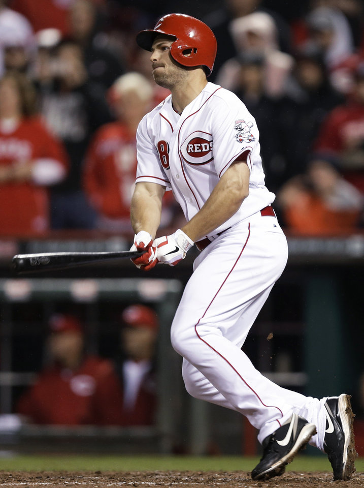 Photo - Cincinnati Reds' Chris Heisey gets a hit with the bases loaded off St. Louis Cardinals relief pitcher Carlos Martinez to drive in the winning run in the bottom of the ninth inning of a baseball game, Thursday, April 3, 2014, in Cincinnati. Cincinnati won 1-0. (AP Photo/Al Behrman)