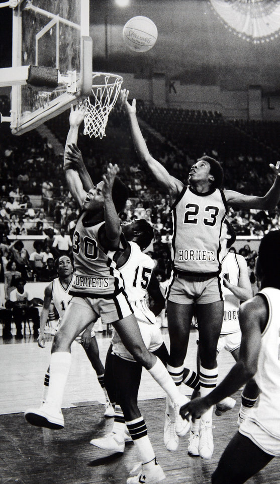 Photo - Former OU basketball player Wayman Tisdale. Wayman Tisdale (23) gets ready to snare a rebound as Tulsa Washington teammate Kevin Gilliam (30) appears to be crying out in anguish during a heated board battle Thursday afternoon against Altus. Staff photo by Don Tullous. Photo taken 3/13/1980, Photo published 3/14/1980 in The Daily Oklahoman. ORG XMIT: KOD