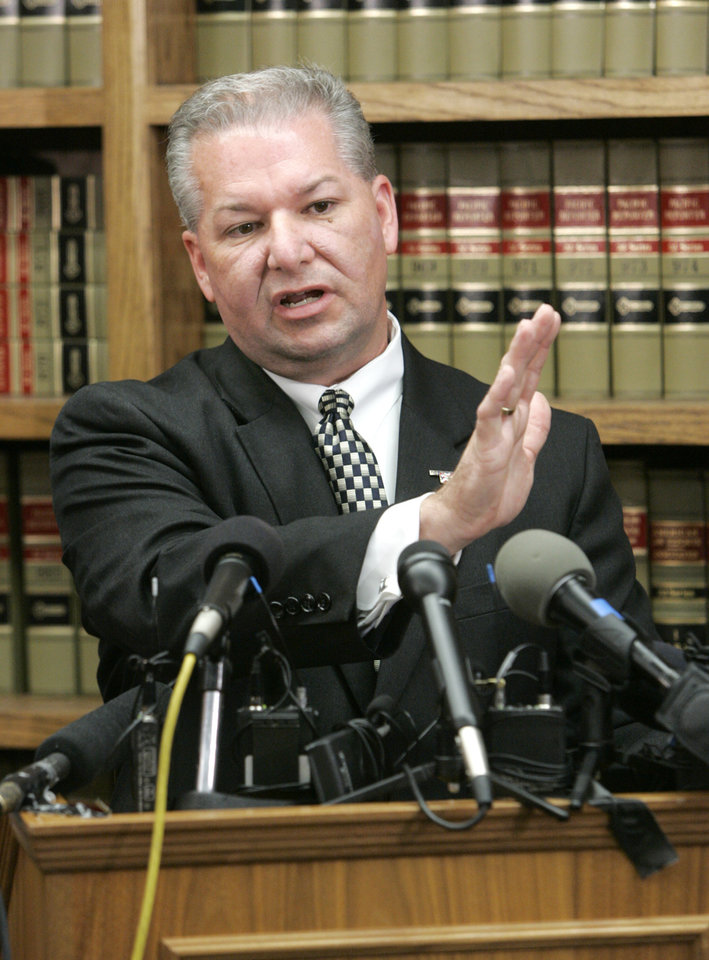 Photo - Oklahoma County District Attorney David Prater describes the attempted robbery of the Reliable Pharmacy at 5900 S Penn. during a press conference in Oklahoma City, Oklahoma May 27, 2009. Pharmacist Jerome Ersland was charged today with first-degree murder in the May 19 shooting death of a would-be robber.  Photo by Steve Gooch, The Oklahoman