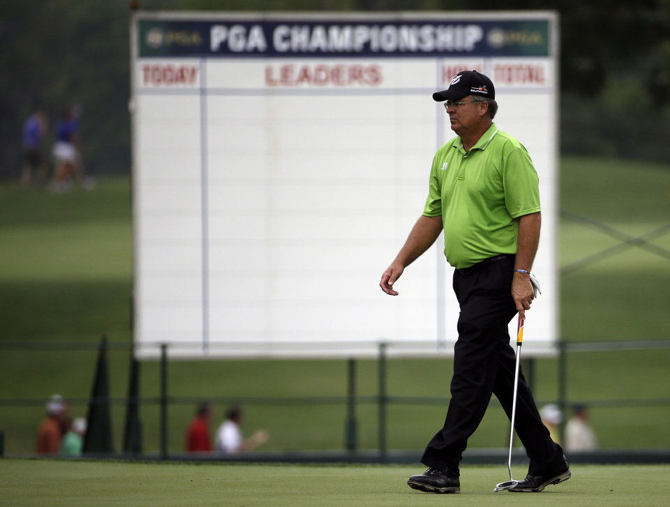 Photo - Kenny Perry walks across the 13th green during a practice round for the PGA Championship golf tournament at Valhalla Golf Club on Tuesday, Aug. 5, 2014, in Louisville, Ky. The tournament is set to begin on Thursday. (AP Photo/David J. Phillip)