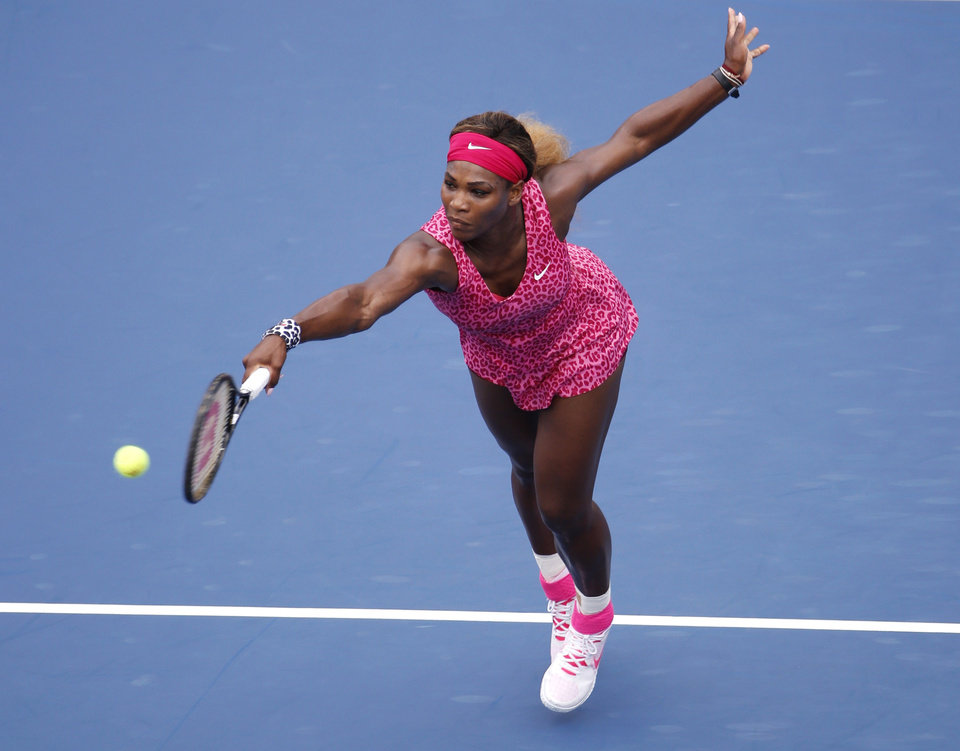Photo - Serena Williams, of the United States, returns a shot to Kaia Kanepi, of Estonia, during the fourth round of the 2014 U.S. Open tennis tournament, Monday, Sept. 1, 2014, in New York. (AP Photo/Seth Wenig)