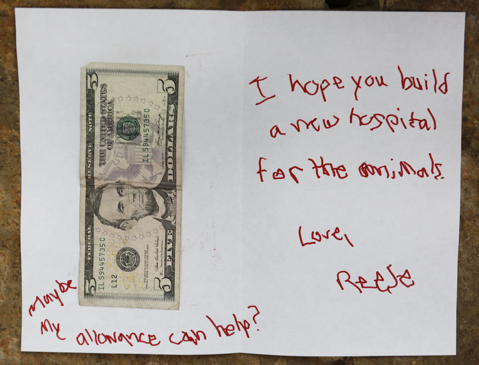Letter and $5 donation from a child for the new hospital at the Oklahoma City Zoo. Photo By Steve Gooch, The Oklahoman <strong>Steve Gooch - The Oklahoman</strong>