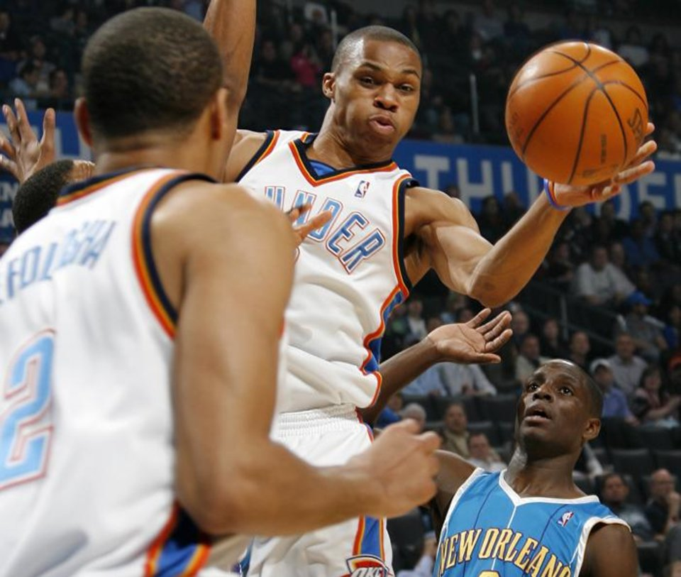 Photo -  Oklahoma City's Russell Westbrook (0) passes the ball in the direction of Thabo Sefolosha (2) as Darren Collison of New Orleans looks on during the NBA basketball game between the New Orleans Hornets and the Oklahoma City Thunder at the Ford Center in Oklahoma City, Wednesday, March 10, 2010. Photo by Nate Billings, The Oklahoman ORG XMIT: KOD
