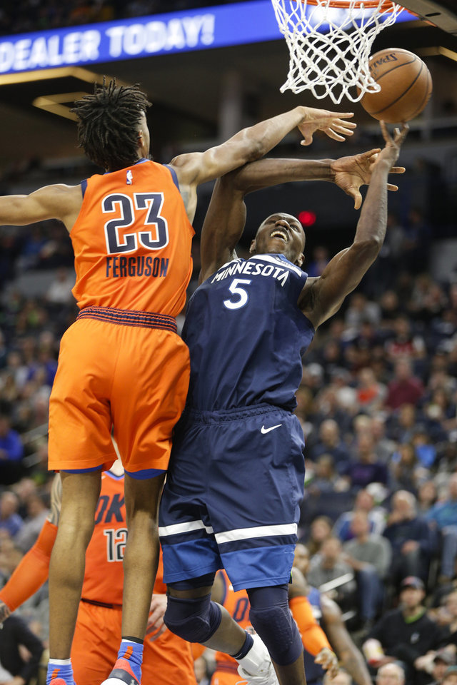 Photo - Minnesota Timberwolves center Gorgui Dieng, of Senegal, (5) is fouled by Oklahoma City Thunder guard Terrance Ferguson (23) as he goes up for a shot during the first half of a NBA basketball game Sunday, April 7, 2019, in Minneapolis. (AP Photo/Paul Battaglia)