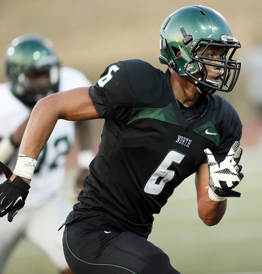 Photo - Norman North's Jordan Evans (6) defends during a high school football scrimmage at Moore Stadium between Edmond Santa Fe and Norman North in Moore, Okla., Thursday, Aug. 16, 2012. Photo by Nate Billings, The Oklahoman
