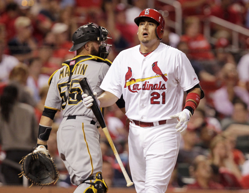 Photo - St. Louis Cardinals' Allen Craig (21) reacts to striking out as Pittsburgh Pirates catcher Russell Martin (55) throws the ball back to the pitcher in the fourth inning of a baseball game, Monday, July 7, 2014 in St. Louis. (AP Photo/Tom Gannam)