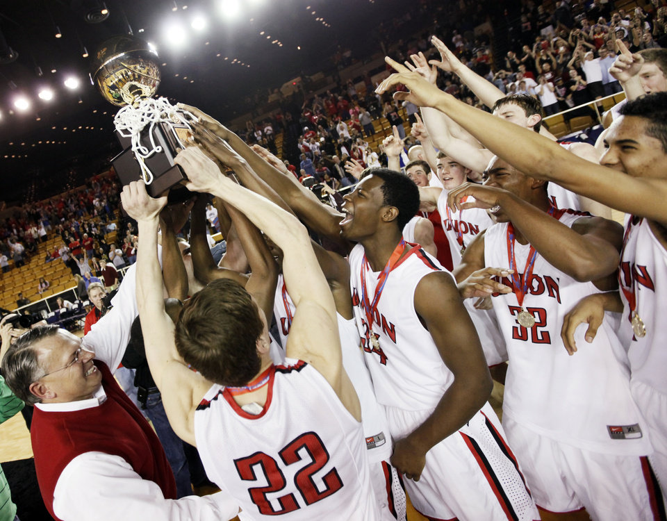 The Union Redskins celebrate with the gold ball championship trophy after the Class 6A boys high school basketball state tournament championship game between Edmond Memorial and Tulsa Union at the Mabee Center in Tulsa, Okla., Saturday, March 10, 2012. Union won, 37-36. Photo by Nate Billings, The Oklahoman