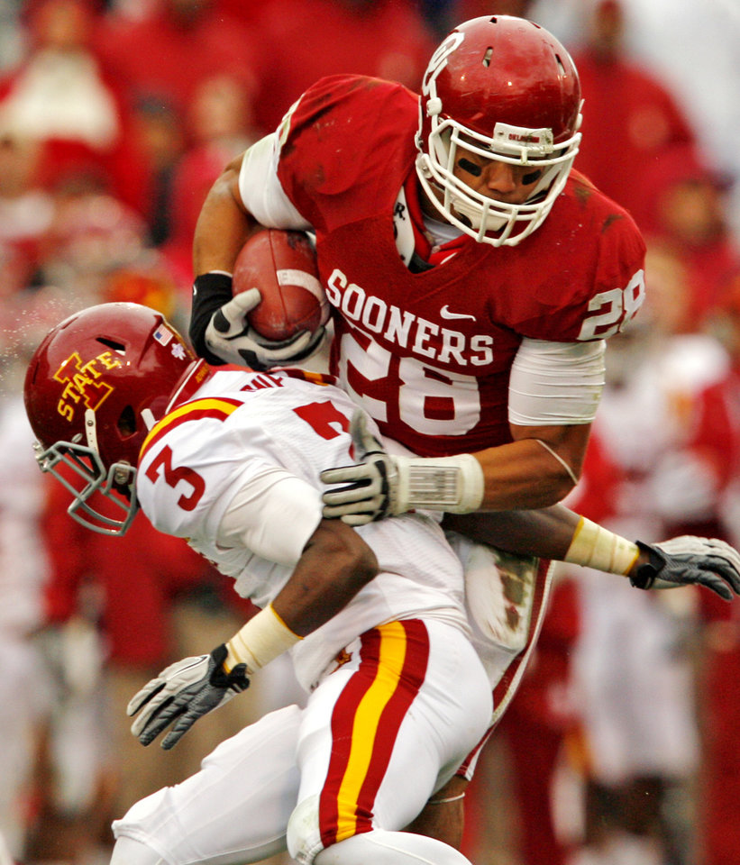 Oklahoma\'s Travis Lewis (28) runs back an interception over Iowa State\'s Kenneth Lynn (3) during a college football game between the University of Oklahoma Sooners (OU) and the Iowa State University Cyclones (ISU) at Gaylord Family-Oklahoma Memorial Stadium in Norman, Okla., Saturday, Nov. 26, 2011. Photo by Steve Sinsey, The Oklahoman