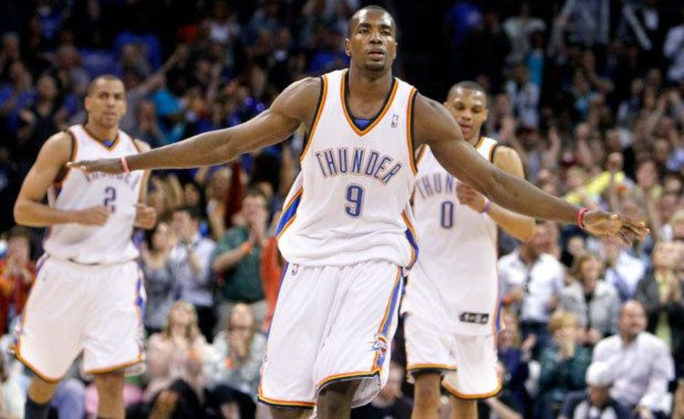 Oklahoma City's Serge Ibaka (9) celebrates a Thunder score during the NBA basketball game between the Oklahoma City Thunder and the Phoenix Suns, Friday, April 9, 2010, at the Ford Center in Oklahoma City. Photo by Sarah Phipps, The Oklahoman