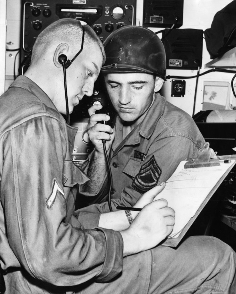 Photo - Letters from home are fine to Thunderbirds but so are messages sent voluntarily by amateur or ham radio operators.  Here Pfc. Dave Nash, Edmond and M/Sgt. Fred Morgan, 2009 NE 21, Oklahoma City, are transcribing.  (For rest of story see back of photo.) Staff photo by unknown.  Photo undated and published on 08/15/1956 in The Daily Oklahoman.