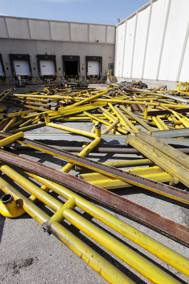 Photo -  Above: Metal being salvaged at the former Bridgestone/Firestone Dayton Tire plant, 2500 S Council Road, now owned by Producers Cooperative Oil Mill and being razed and recycled in preparation to market the land, some 170 acres.   PAUL B. SOUTHERLAND -