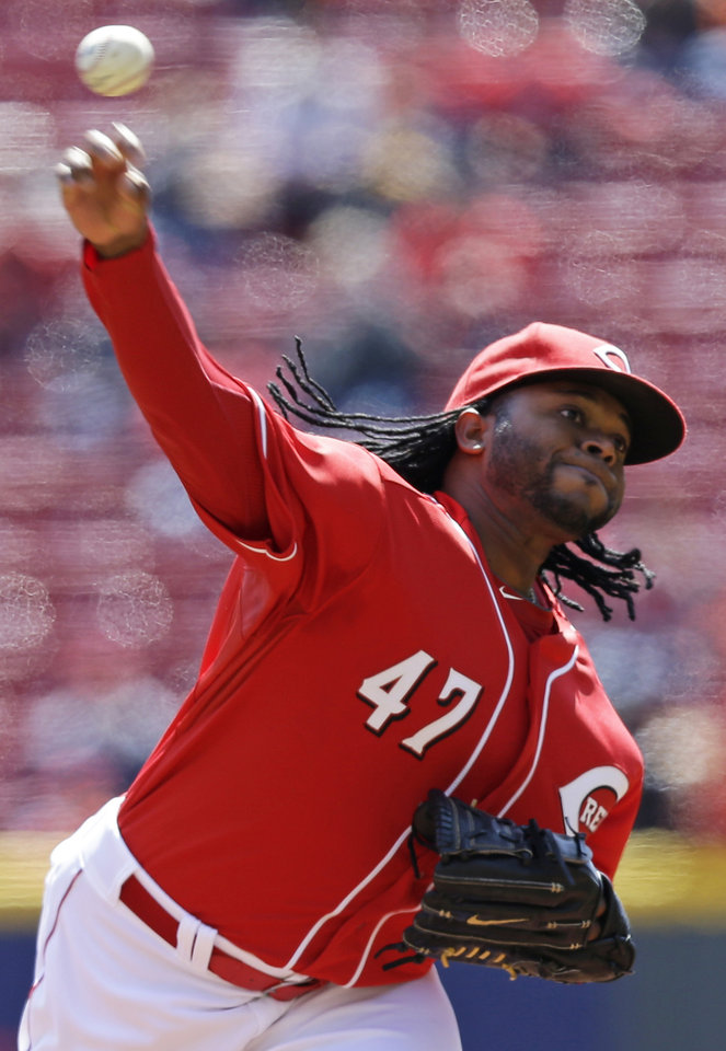 Photo - Cincinnati Reds starting pitcher Johnny Cueto throws against the Pittsburgh Pirates in the first inning of a baseball game, Wednesday, April 16, 2014, in Cincinnati. (AP Photo/Al Behrman)