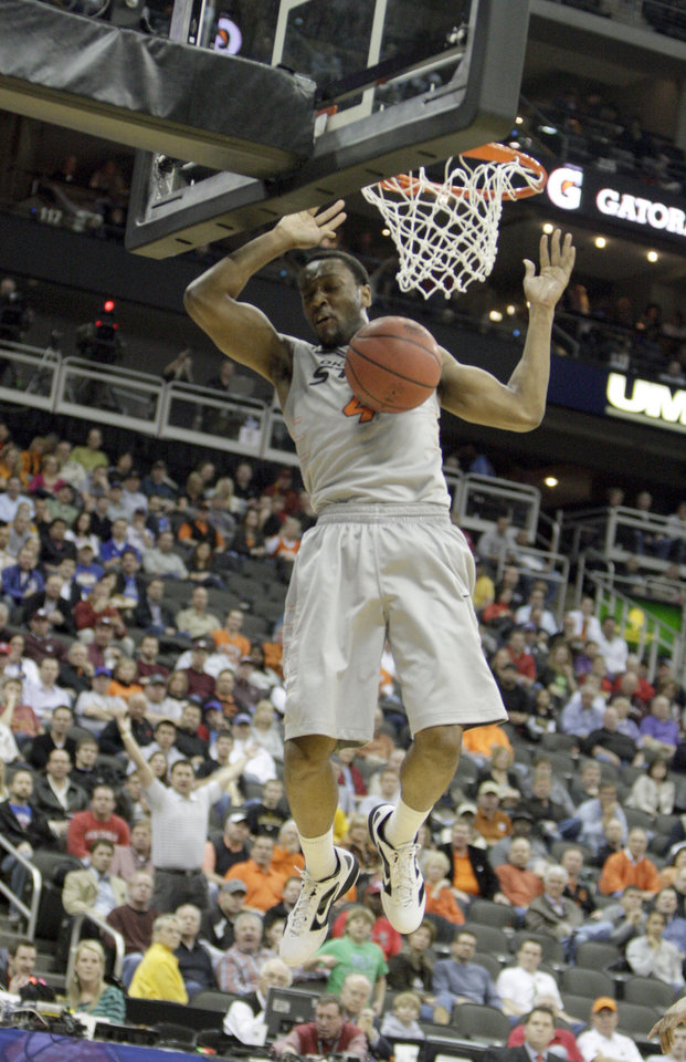 Photo - Oklahoma State's Brian Williams (4) dunks the ball during the Big 12 tournament men's basketball game between the Oklahoma State Cowboys and the Texas Tech Red Raiders at the Sprint Center, Wednesday, March, 7, 2012. Photo by Sarah Phipps, The Oklahoman