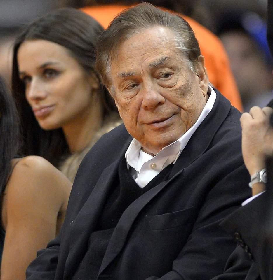 Photo - FILE - In this Oct. 25, 2013, file photo, Los Angeles Clippers owner Donald Sterling attends a Clippers game against the Sacramento Kings in Los Angeles. With the potentially record-breaking $2 billion sale of the Los Angeles Clippers hanging in the balance, a trial beginning Monday, July 7, 2014 will focus on whether Donald Sterling's estranged wife had the authority under terms of a family trust to unilaterally negotiate the deal. (AP Photo/Mark J. Terrill, File)