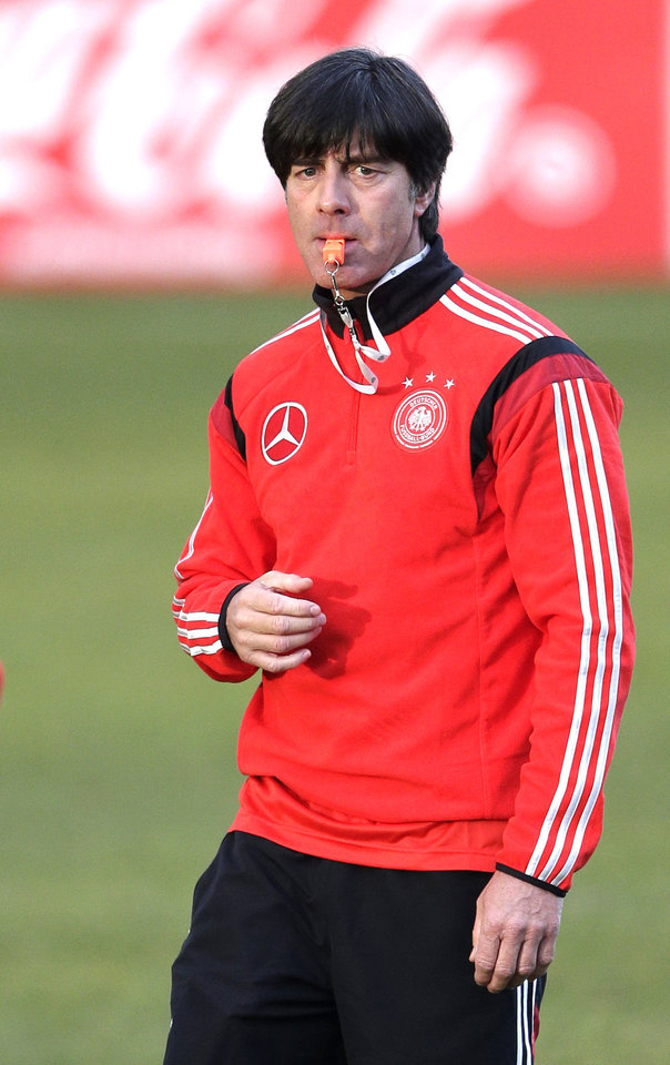 Photo - Germany's head coach Joachim Loew watches his players during a training session prior to the international friendly soccer match between Germany and Chile in Stuttgart, southern Germany, Monday, March 3, 2014. Germany will face Chile on Wednesday. (AP Photo/Matthias Schrader)