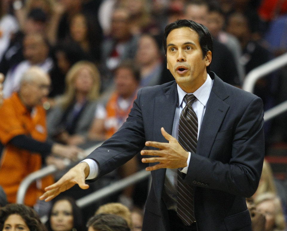 Miami Heat head coach Eric Spoelstra reacts after a foul on his team in the first quarter against the Phoenix Suns during an NBA basketball game on Saturday, Nov. 17, 2012, in Phoenix. (Rick Scuteri/AP Photos)