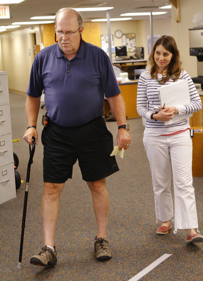 Maj. John Waldenville, an Oklahoma County Sheriff's deputy who was shot in the head last year while being robbed in the Stockyards, will be honored at Integris event on Saturday.  He is shown during a rehab therapy session with occupational therapist Jennifer Curry at Jim Thorpe North on Thursday. <strong>Jim Beckel - THE OKLAHOMAN</strong>