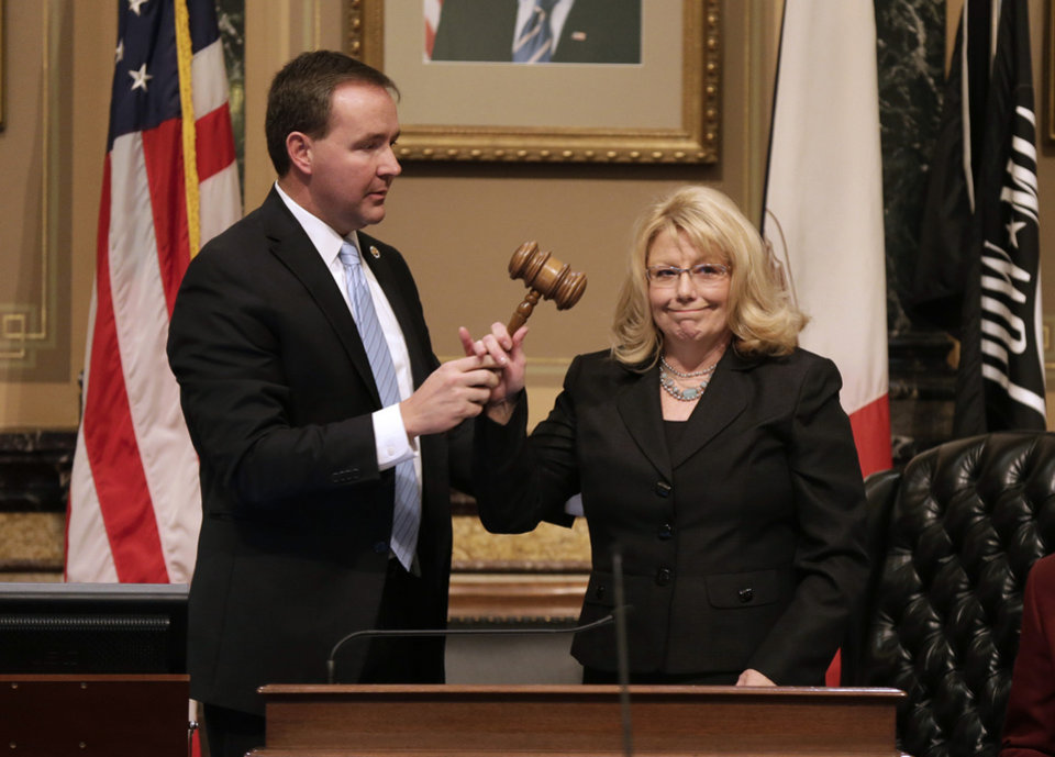 Photo - Sen. Pam Jochum, D-Dubuque, gets the gavel from Sen. Jeff Danielson, D-Waterloo, left, after being sworn in as President of the Iowa Senate during the opening day of the Iowa Legislature, Monday, Jan. 14, 2013, at the Statehouse in Des Moines, Iowa. (AP Photo/Charlie Neibergall)
