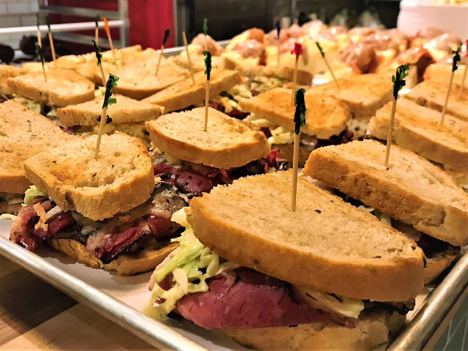 Photo -  A tray of pastrami sandwiches from Scottie's Deli in Oklahoma City's Uptown 23rd entertainment district. [Photo by Dave Cathey, The Oklahoman]