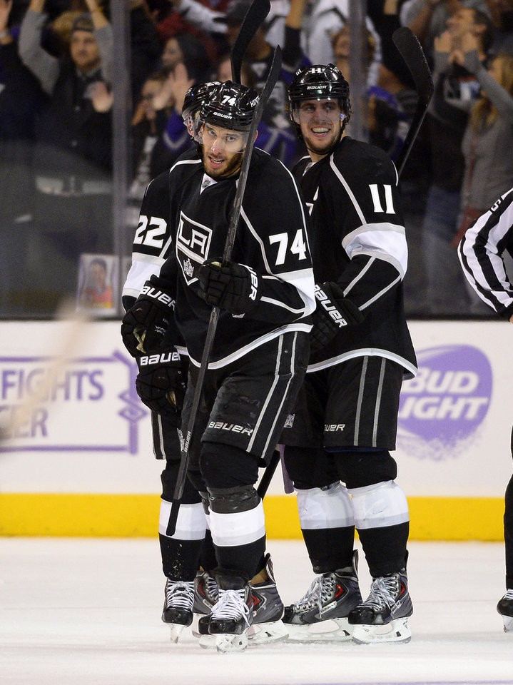 Photo - Los Angeles Kings center Dwight King, left, celebrates his third goal of the game with center Anze Kopitar, of Slovenia, during the third period of their NHL hockey game against the Phoenix Coyotes, Thursday, Oct. 24, 2013, in Los Angeles. (AP Photo/Mark J. Terrill)