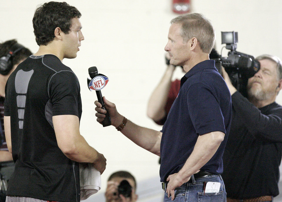 Photo - NFL FOOTBALL / PROFESSIONAL FOOTBALL / PRO FOOTBALL: Sam Bradford, left talks with the NFL Network's Mike Mayock after his NFL Pro Day workout at the Everest Training Center at The University of Oklahoma (OU) in Norman, Oklahoma March 29 , 2010. Photo by Steve Gooch, The Oklahoman ORG XMIT: KOD