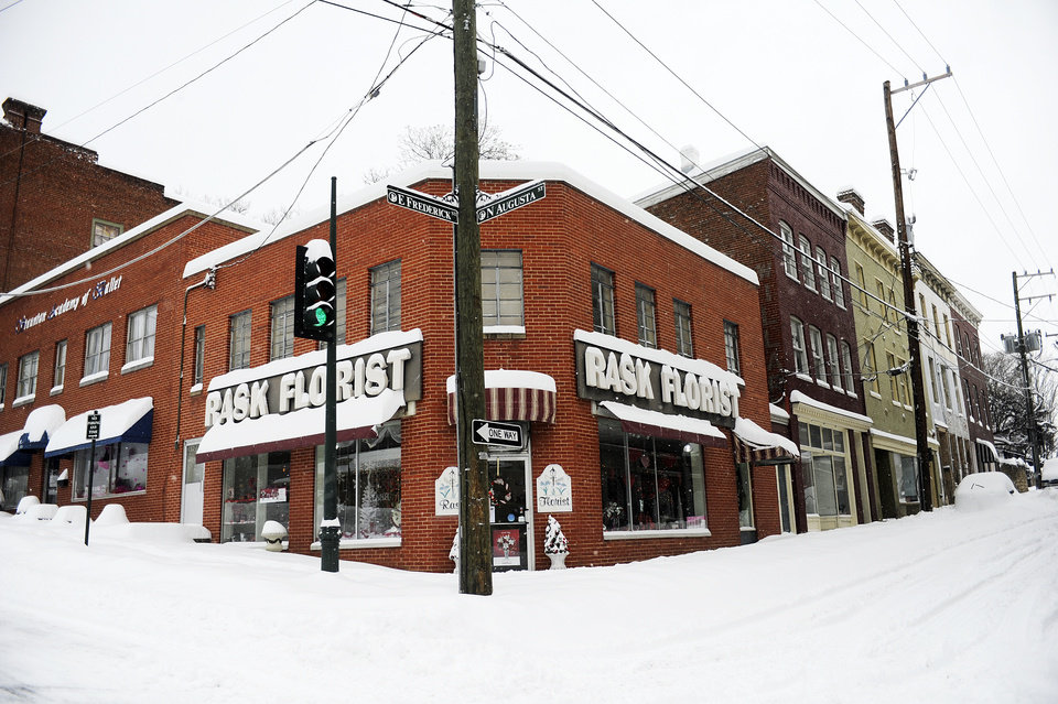 Photo - Snow piles up outside of Rask Florist after a snowstorm accumulating over a foot of snow fell on Thursday, Feb. 13, 2014, in Staunton, Va. (AP Photo/The News Leader, Katie Currid)