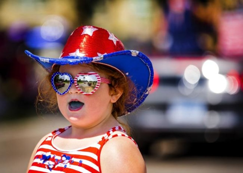 Photo -  Megan Hull, 8, is dressed for the occasion as she takes in the sights of the Bethany Freedom Festival parade.    [Chris Landsberger/The Oklahoman]