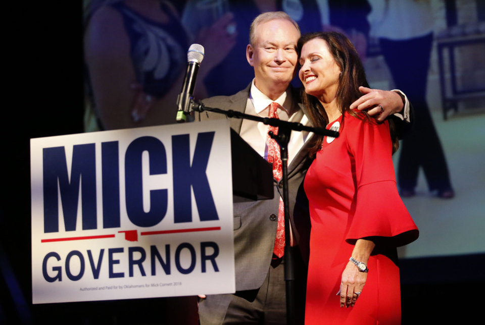 Photo - Mick Cornett and his wife Terri after giving a concession speech during a watch party at the Tower Theatre in Oklahoma City , Tuesday, Aug. 28, 2018. Photo by Sarah Phipps, The Oklahoman