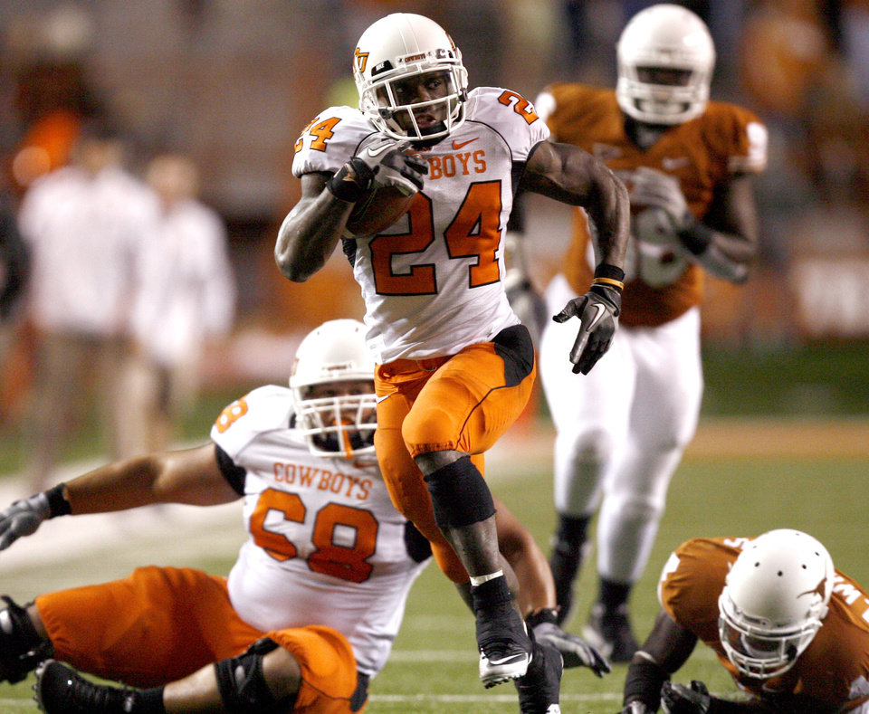 Photo - Oklahoma State's Kendall Hunter (24) runs upfield during the college football game between the Oklahoma State University Cowboys (OSU) and the University of Texas Longhorns (UT) at Darrell K Royal-Texas Memorial Stadium in Austin, Texas, Saturday, November 13, 2010. Photo by Sarah Phipps, The Oklahoman