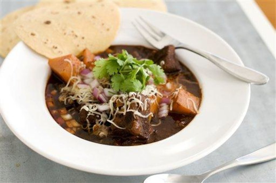 Photo - In this image taken on January 7, 2013, Mexican beef brisket and winter squash chili is shown served in a bowl in Concord, N.H. (AP Photo/Matthew Mead)
