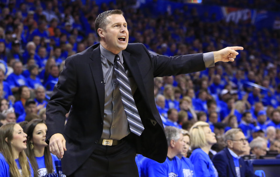 Photo - Memphis Grizzlies head coach David Joerger reacts to a call against his team as they play the Oklahoma City Thunder during the first quarter of Game 1 of the opening-round NBA basketball playoff series in Oklahoma City on Saturday, April 19, 2014. (AP Photo/Alonzo Adams)