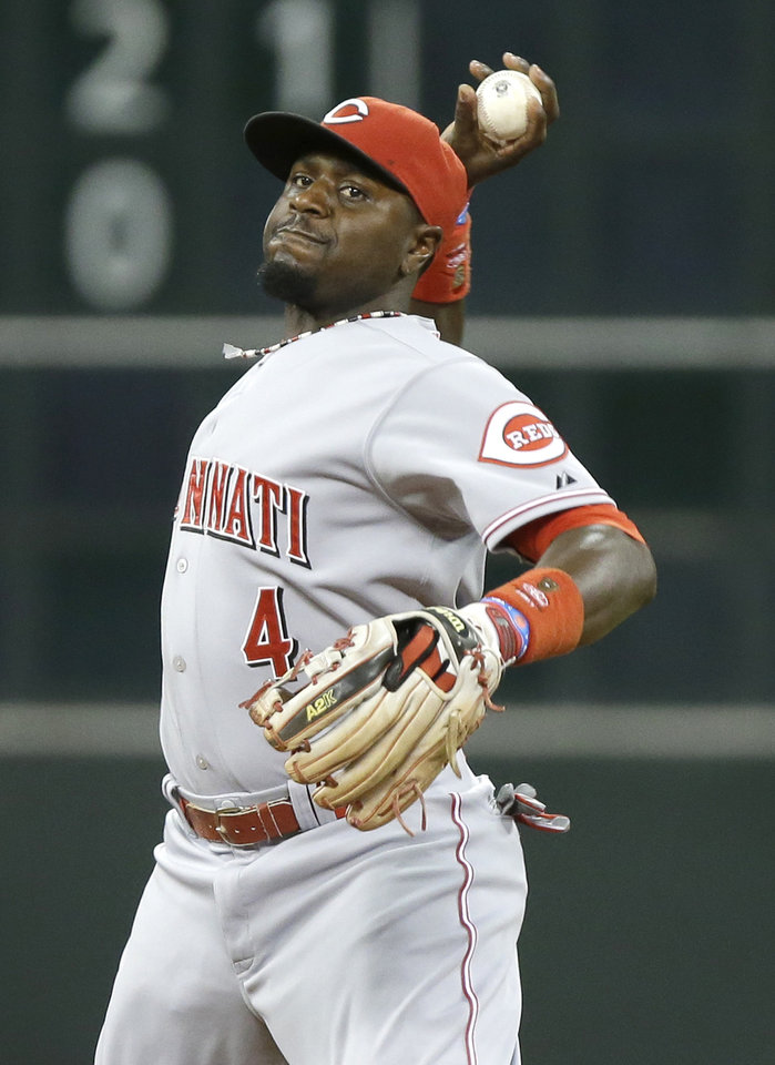 Photo - Cincinnati Reds second baseman Brandon Phillips fires the ball to first base for the out after fielding a grounder by Houston Astros' Jonathan Villar in the third inning of a baseball game Wednesday, Sept. 18, 2013, in Houston. (AP Photo/Pat Sullivan)