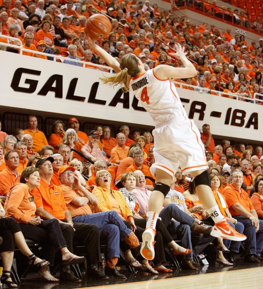 Photo -  The crowd reacts as Oklahoma State's Liz Donohoe (4) reaches for the ball during the  WNIT semifinal college basketball game between Oklahoma State University and San Diego at Gallagher-Iba Arena in Stillwater, Okla., Wednesday, March 28, 2012. Oklahoma State won 73-57. Photo by Bryan Terry, The Oklahoman