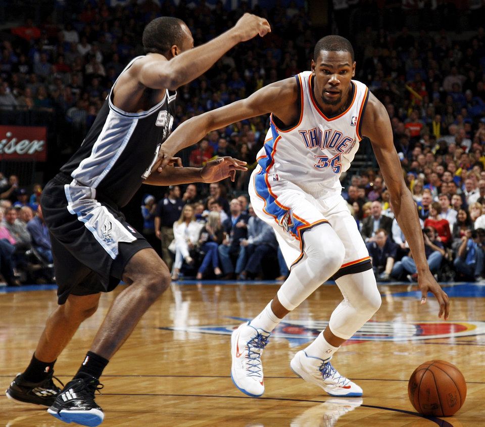 Photo - Oklahoma City's Kevin Durant (35) drives the ball against San Antonio's James Anderson (11) during an NBA basketball game between the Oklahoma City Thunder and the San Antonio Spurs in Oklahoma City Monday, Dec. 17, 2012. Oklahoma City won, 107-93. Photo by Nate Billings, The Oklahoman