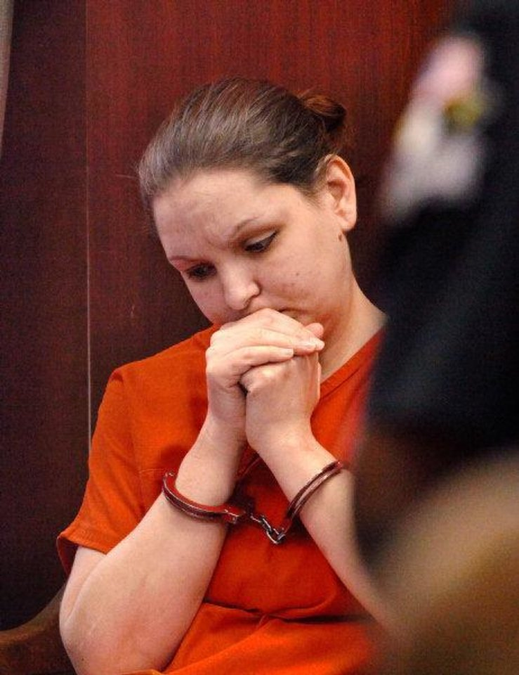 Photo - Lorena Amanda Hodges waits in court to be taken back to jail after being sentenced for kidnapping, assault and maiming.   JIM BECKEL - THE OKLAHOMAN