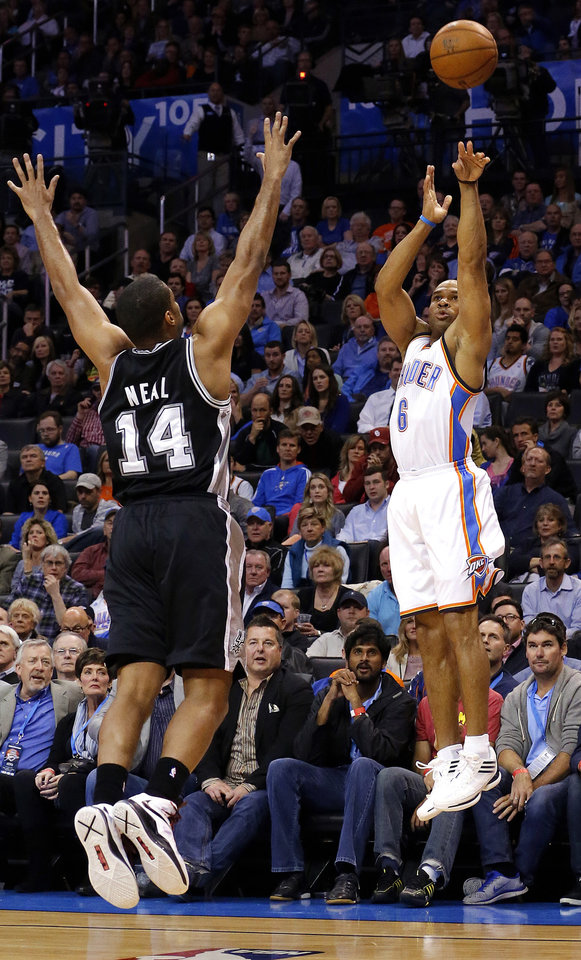 Photo - Oklahoma City's Derek Fisher (6) shoots a three-point shot over San Antonio's Gary Neal (14) during the NBA game between the Oklahoma City Thunder and the San Antonio Spurs at the Chesapeake Energy Arena, Thursday, April 4, 2013. Photo by Sarah Phipps, The Oklahoman