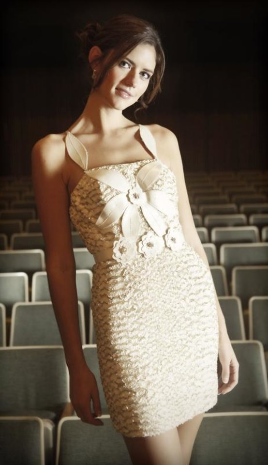 Terani gold and cream sequin dress with floral appliques from Tres Chic.  Model is from Layman Agency.  Photo by Chris Landsberger, The Oklahoman.