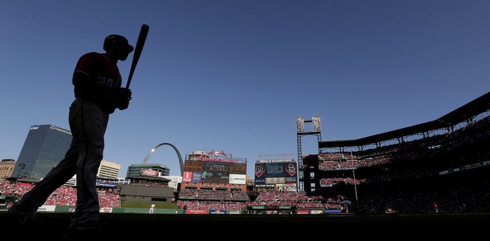 Washington Nationals' Ian Desmond heads to the batter's box during the sixth inning of Game 1 of the National League division baseball series against the St. Louis Cardinals, Sunday, Oct. 7, 2012, in St. Louis. (AP Photo/Charlie Riedel)