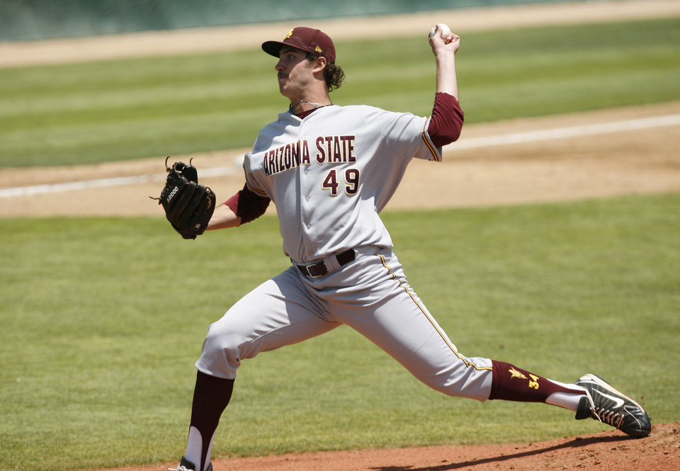 Photo - Arizona State pitcher Ryan Kellogg delivers during the first inning of an NCAA college baseball tournament regional game against Sacramento State on Saturday, May 31, 2014, in San Luis Obispo, Calif. (AP Photo/Aaron Lambert)