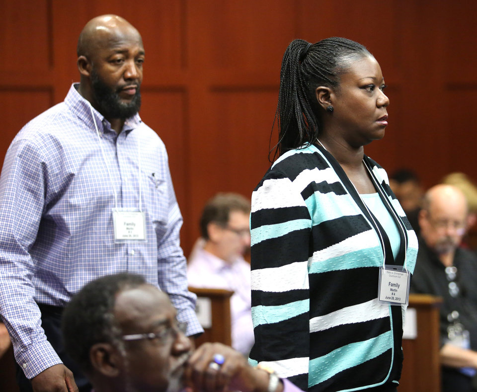Photo - The parents of Trayvon Martin, Tracy Martin, left, and Sybrina Fulton arrive for the the 15th day of George Zimmerman's trial in Seminole circuit court, in Sanford, Fla., Friday, June 28, 2013. Zimmerman has been charged with second-degree murder for the 2012 shooting death of Trayvon Martin.(AP Photo/Orlando Sentinel, Joe Burbank, Pool)