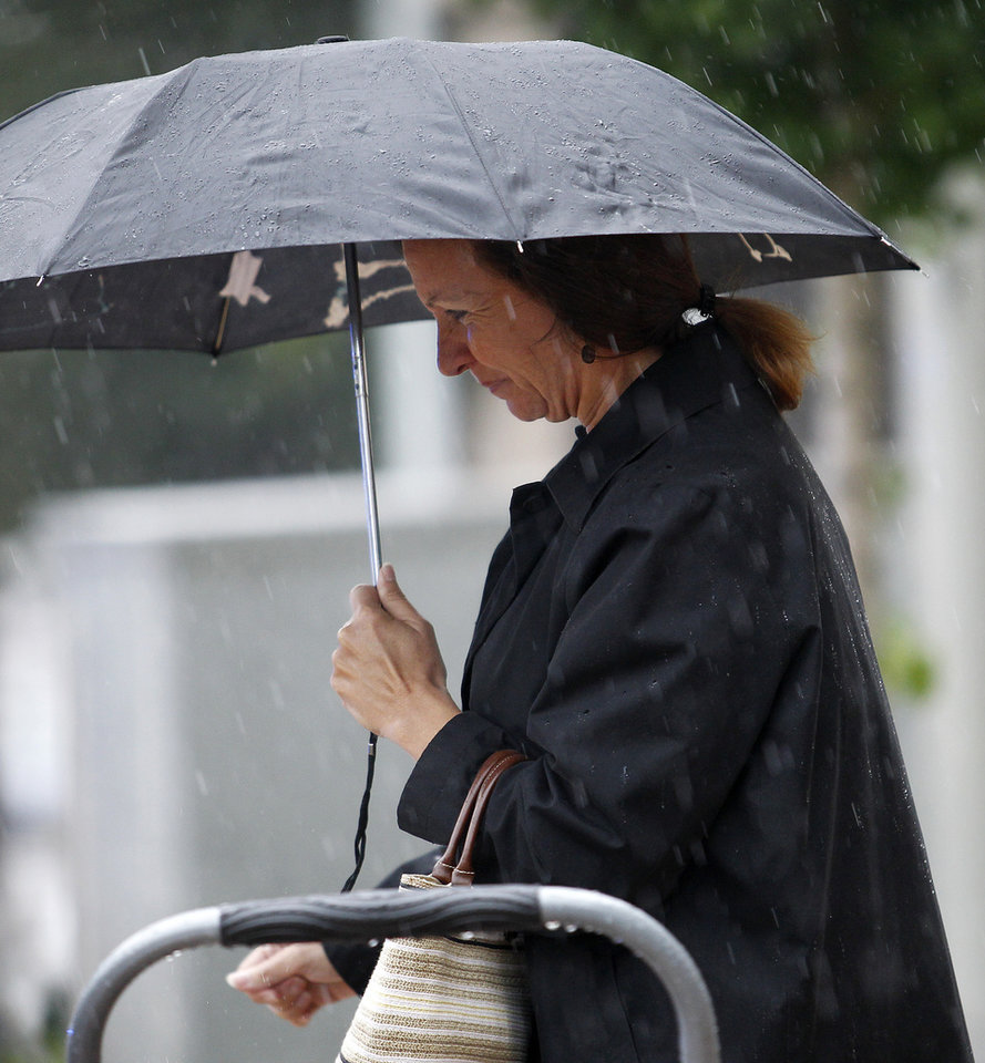 Photo -   Lora Haggard, who was in charge of campaign finance compliance for former U.S. Sen. John Edwards, exits a federal courthouse in Greensboro, N.C., after testifying in his trial Monday, May 14, 2012. Edwards has pleaded not guilty to six criminal counts related to campaign finance violations. (AP Photo/Bob Leverone)