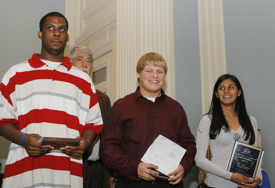 Photo - Melvin McKee, a senior at the Oklahoma School for the Deaf, Caleb Dickenson and Alex Ontiveros, both seniors fro Bethany High School, with their awards at the Students with Disabilities Technology Awards at the state Capitol, Monday, May 4, 2009.   Photo By David McDaniel, The Oklahoman.