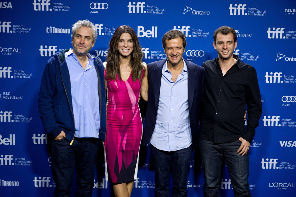 "Photo - Cast and crew of ""Gravity,"" from left, director Alfonso Cuaron, actress Sandra Bullock, producer David Heyman and writer Jonas Cuaron pose for a picture during a photo call at the 2013 Toronto International Film Festival in Toronto on Monday, Sept. 9, 2013. (AP Photo/The Canadian Press, Galit Rodan) ORG XMIT: GYR110"