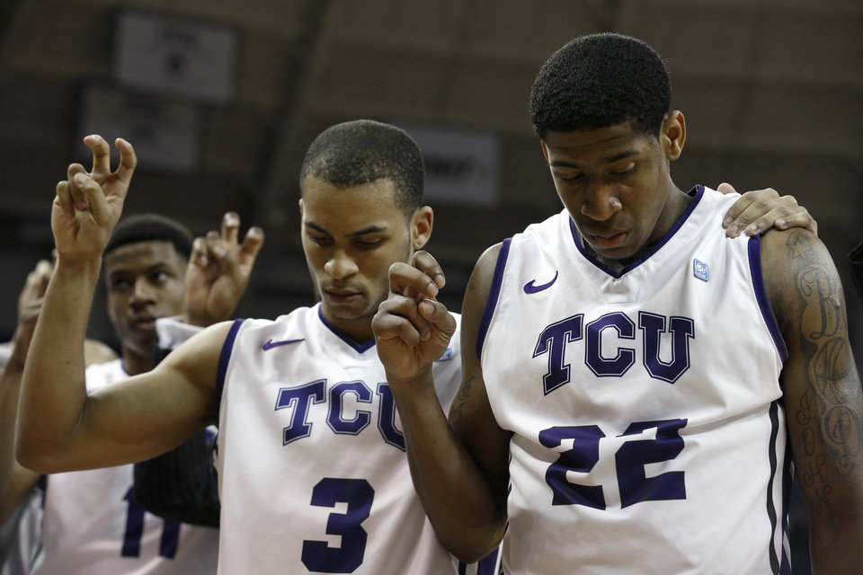Photo - TCU guards Clyde Smith III (3)  and Jarvis Ray (22) listen to the school song after an NCAA college basketball game against Oklahoma Saturday, March 8, 2014, in Fort Worth, Texas. TCU went 0-18 this season with Oklahoma winning 97-67. (AP Photo/Sharon Ellman)