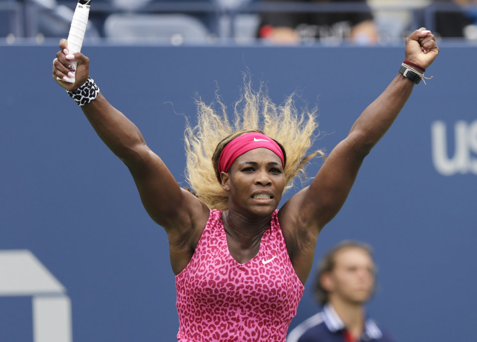 Photo - Serena Williams, of the United States, reacts after a point against Kaia Kanepi, of Estonia, during the fourth round of the 2014 U.S. Open tennis tournament, Monday, Sept. 1, 2014, in New York. (AP Photo/Charles Krupa)