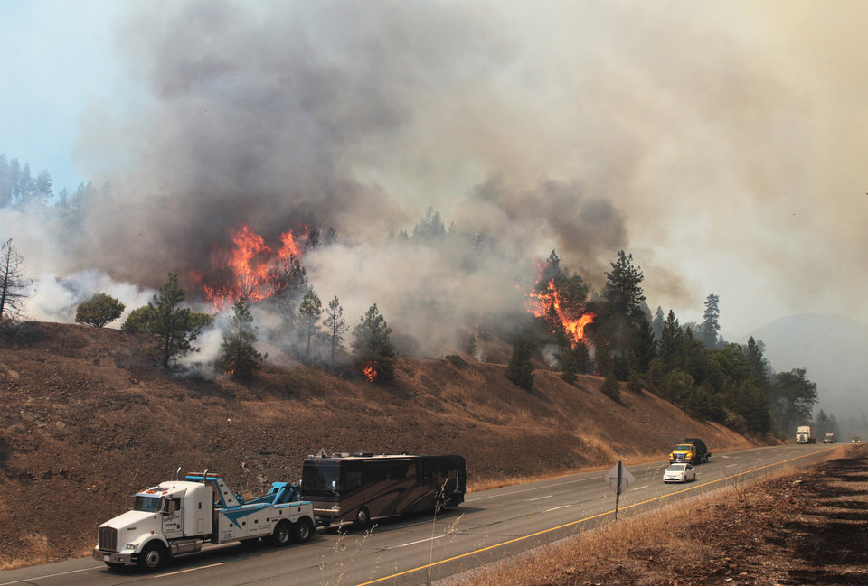 Firefighters work the Salt Creek Fire Wednesday, Aug. 1, 2012, near Interstate 5 and Gilman Road in Shasta County, Calif. AP photo
