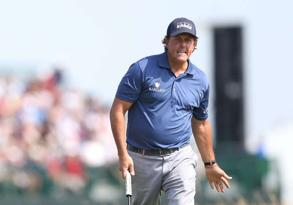 Photo - Phil Mickelson of the US urges his ball on after putting on the 6th green during the second day of the British Open Golf championship at the Royal Liverpool golf club, Hoylake, England, Friday July 18, 2014. (AP Photo/Scott Heppell)
