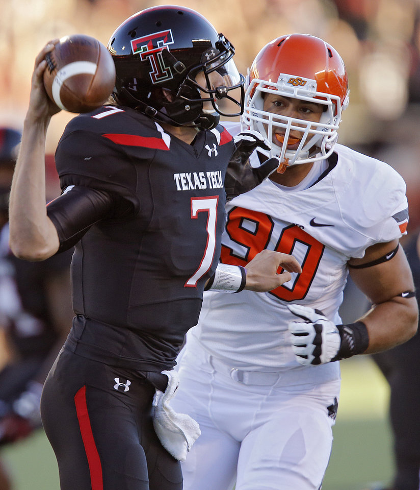 Oklahoma State \'s Trace Clark (90) puts pressure on Texas Tech\'s Davis Webb (7) during the college football game between the Oklahoma State University Cowboys (OSU) and the Texas Tech University Red Raiders (TTU) at Jones AT&T Stadium in Lubbock, Tex. on Saturday, Nov. 2, 2013. Photo by Chris Landsberger, The Oklahoman