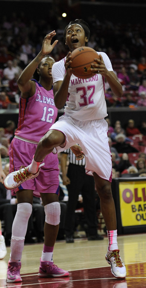 Photo - Maryland's Shatori Walker-Kimbrough, right, shoots as Clemson's Quinyotta Pettaway defends in the second half of an NCAA college basketball game on Sunday, Feb. 9, 2014, in College Park, Md. Maryland won 95-43. (AP Photo/Gail Burton)